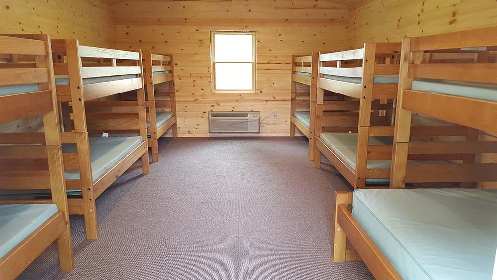 Image of a summer camp bunkbed.